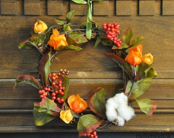Festive Fall Wreath Featuring Orange Chinese Lanterns, Red Berries, Greenery, and Cotton