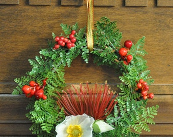 Small New Zealand Christmas Wreath Featuring Pohutukawa, Mt. Cook Lily, Karamu Berries, Swamp Maire, and Silver Fern with Gold & Red Ribbon