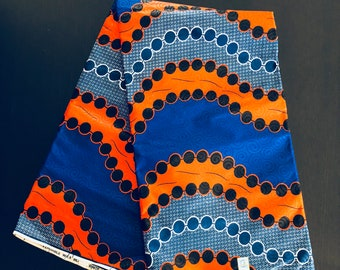African Fabric - by the yard - Wax/Dutch - blue, orange, white and black - circled pattern