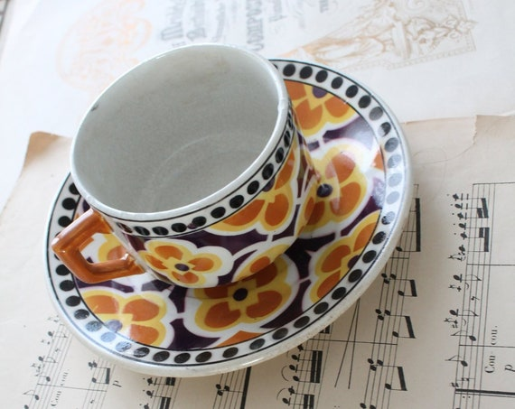 A Tea Cup and its saucer from the pottery Moulin des Loups Orchies