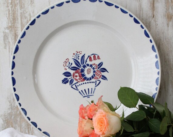 Large antique French round serving plate with a bouquet of flowers pattern. Pattern TOURNY.