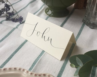 Ivory place card featuring hand lettered modern calligraphy personalisation