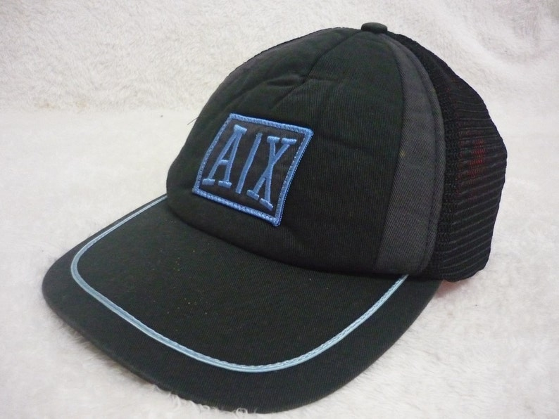 1a229c24e31 Vintage AX ARMANI EXCHANGE Embroidered Spellout Logo Snapback