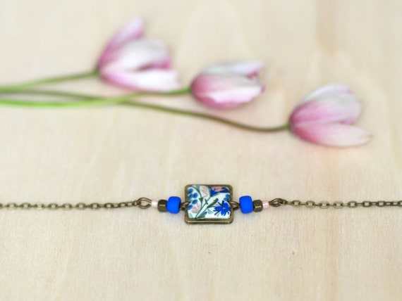 Blue and pink dainty bracelet with handmade floral patterns on brass square 'Seradelle'