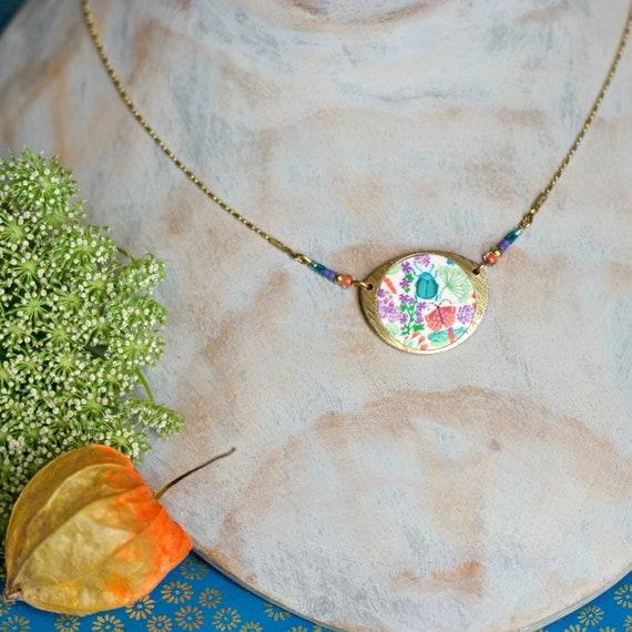 Circle pendant with handmade floral patterns on raw brass chain, 'Aglais' series