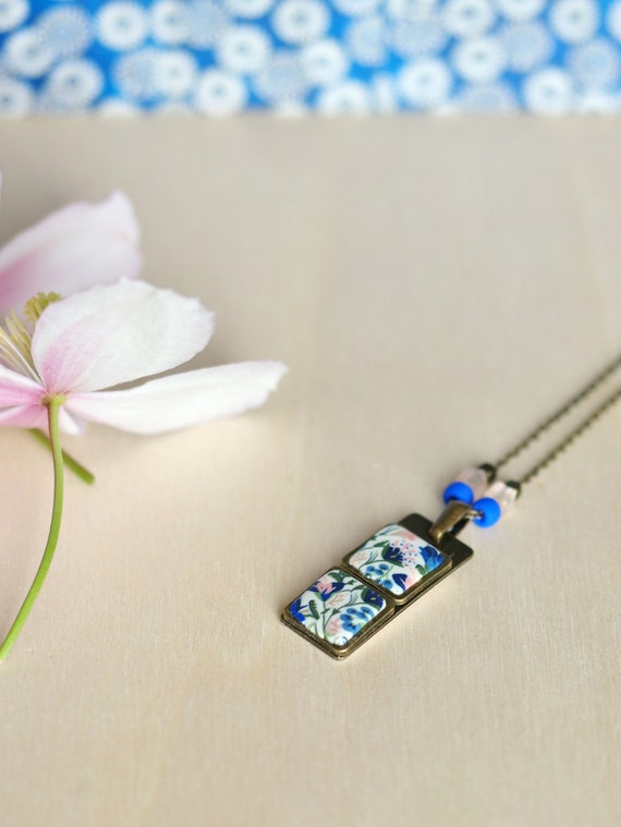 Blue and pink pendant necklace with handmade floral patterns on brass chain 'Seradelle'