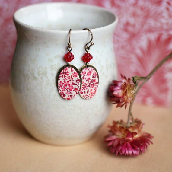 Pendant earrings with a handmade red floral pattern on antique brass oval, 'Astrance' series'