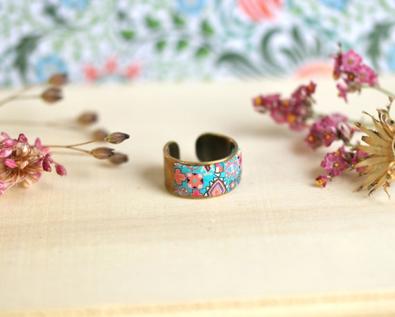 Large brass ring and pink and turquoise ethnic motifs, 'Azolla' series