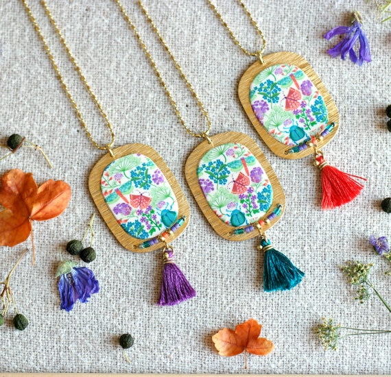 Long necklace with handmade floral patterns and orange, green or purple tassel, 'Aglais' series