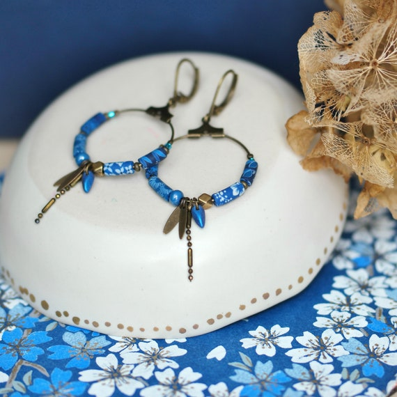 Hoop earrings in brass with handmade blue beads and tassels, 'Cleonia' series