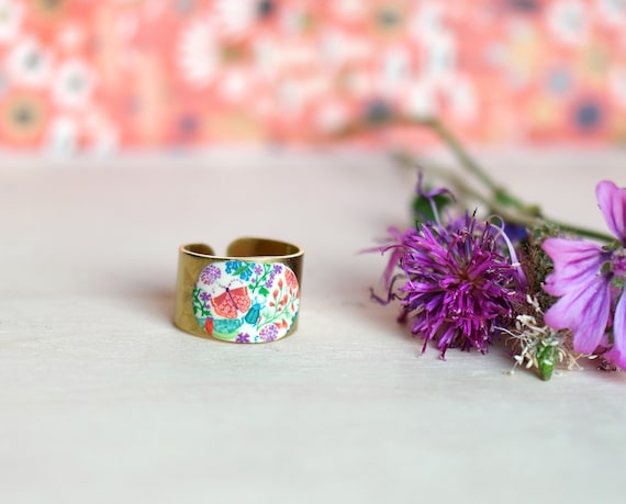 Wide brass ring with orange, green and purple flower and insect motifs, 'Aglaïs' series