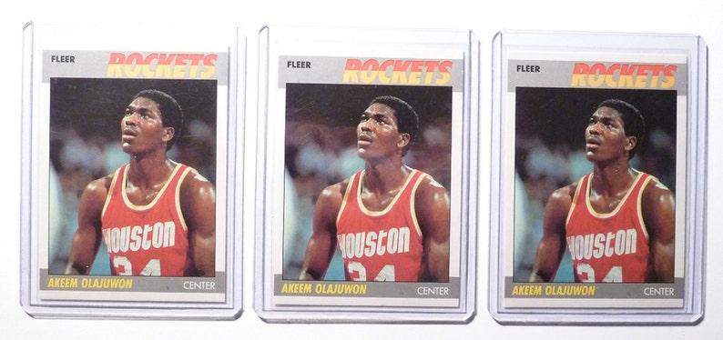 80 of 132 - 1987 Fleer Basketball Cards Akeem Olajuwon Lot of Three 3 No