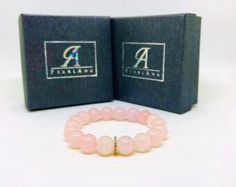 Pave diamond and natural rose quartz bracelet