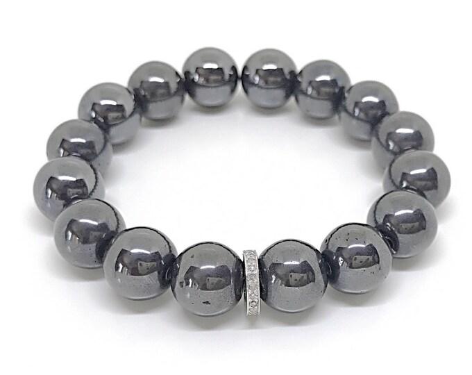 Gray gemstone and 0,22 carat diamond bracelet