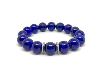 Blue lapis lazuli gemstone and 0.44 carat diamond bracelet