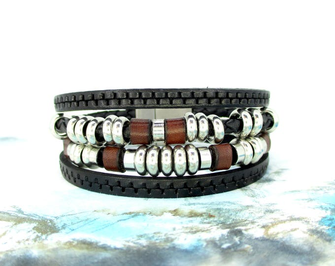 Black leather bracelet.