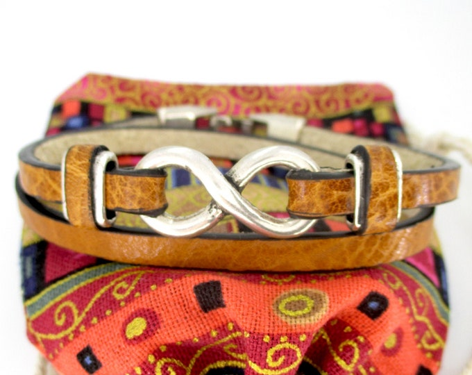 Double light brown leather bracelet with infinity and secure hook closure.