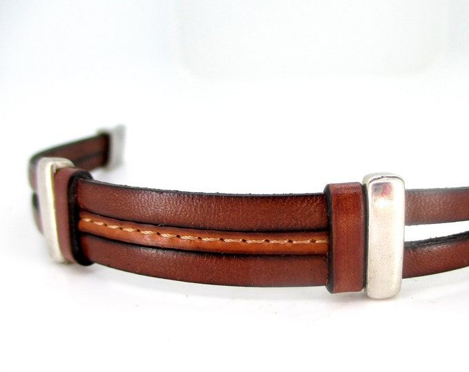 Stitched cognac brown leather bracelet, with two smooth leather straps and stainless steel magnet clasp.