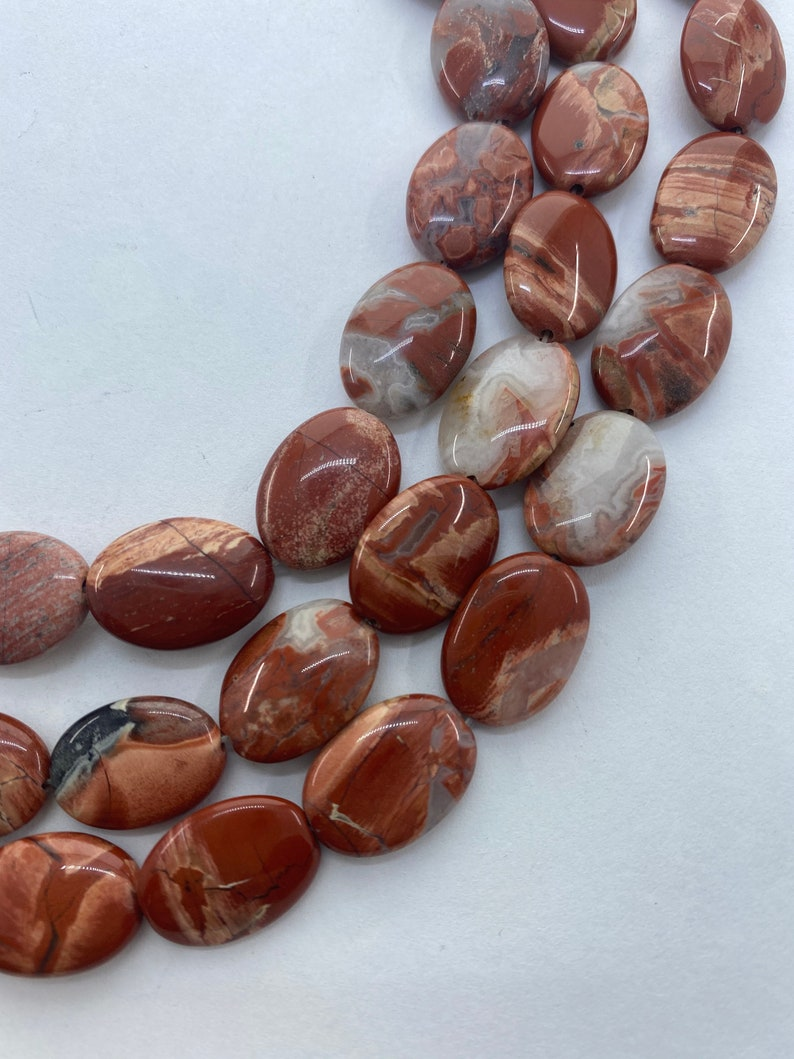 13x18mm Oval Red Bend Jasper Gemstone Beads 15\u201d strand of flat oval Jasper beads Red Jasper with orange pink and white. 22 per strand