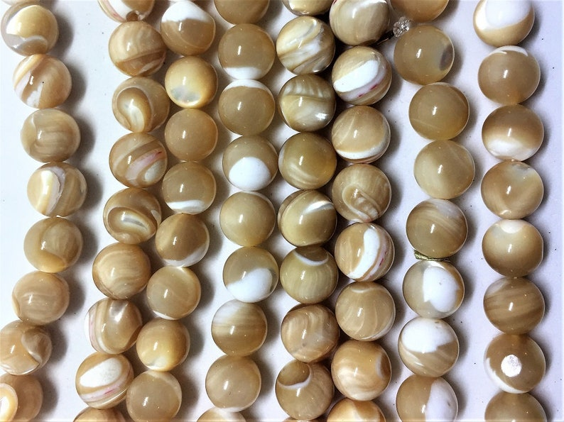 roughly 48 beads per strand. 8mm Natural Mother of Pearl Gemstone Beads 15 strand of round beads