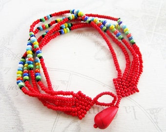 """Bracelet weaved in seed type """"Maasai"""", red and multicolor"""