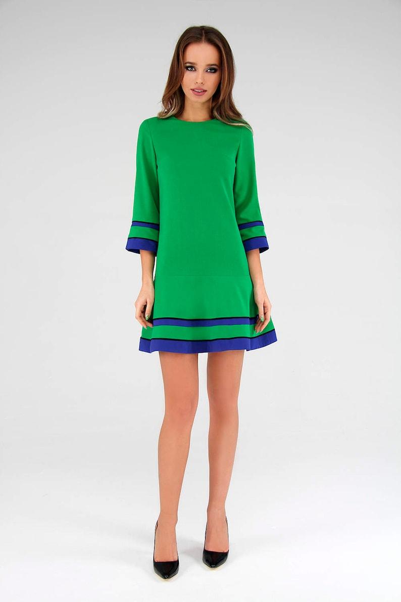Green dress with a flared skirt Green dress A silhouette green dress