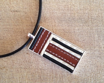 Black leather, silver pendant and leather necklace