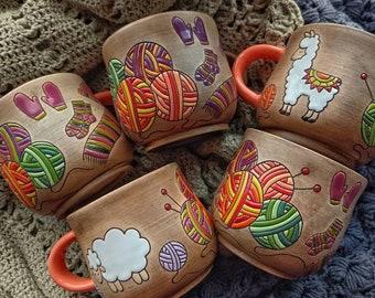 Knitter's handmade ceramic mug with yarn