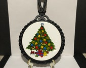 Christmas Tree with Angel on top wall plaque trivet cast iron and ceramic marked action and orient