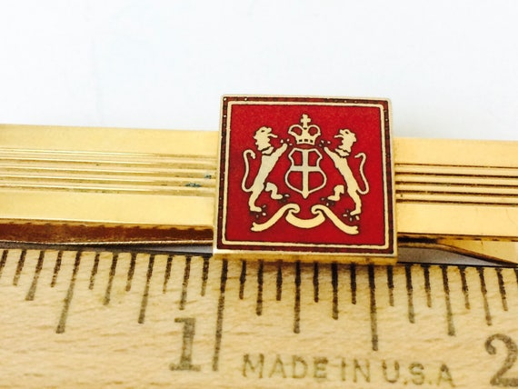 Vintage Gold Tone Tie Bar With An Enamel Crest With Lions