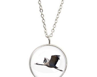 Twitches pendants etsy flying crane bird image on pendant and silver plated necklace aloadofball Images