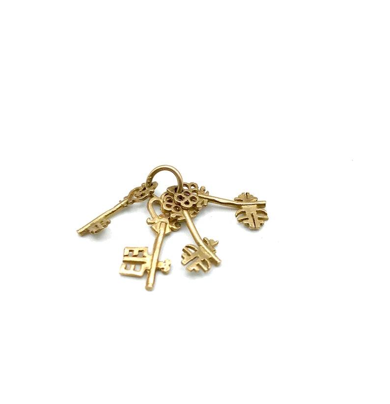 Set of 4 Skeleton Key Charms on a Ring 9KT Gold