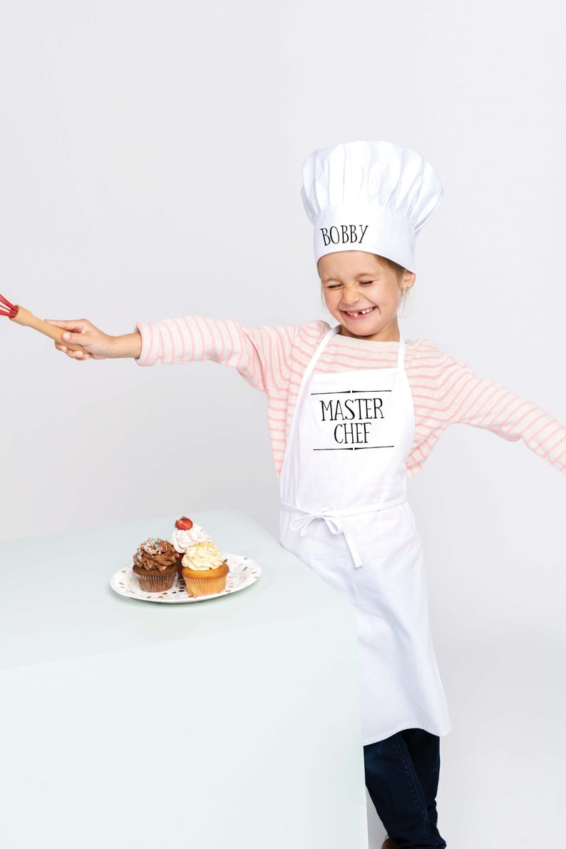 Personalised Children's Apron & Chefs Hat Gift Set. Says image 0