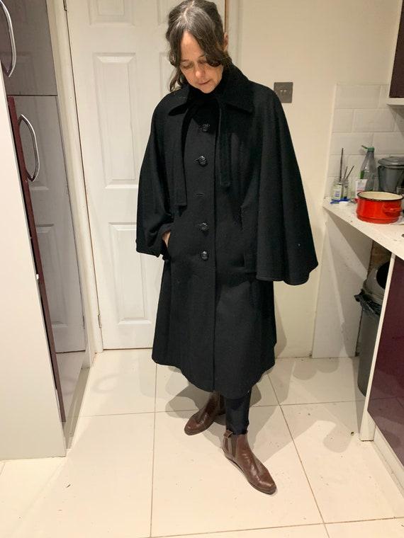 Black cape style coat
