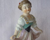 Antique Dresden-type Porcelain Figurine of a Young Girl Dancing, Volkstedt crossed mark in blue.