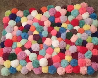 Colourful pompom rug