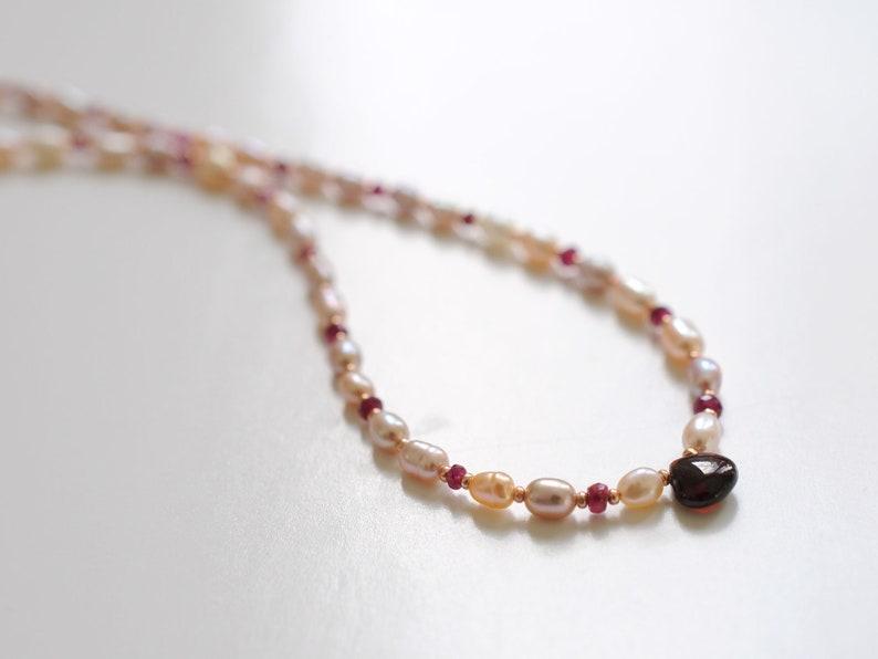 Pearl necklace with garnet gemstones January birthstone image 0