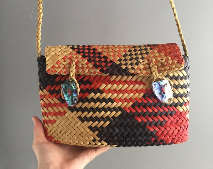 woven shoulder bag with shell buttons