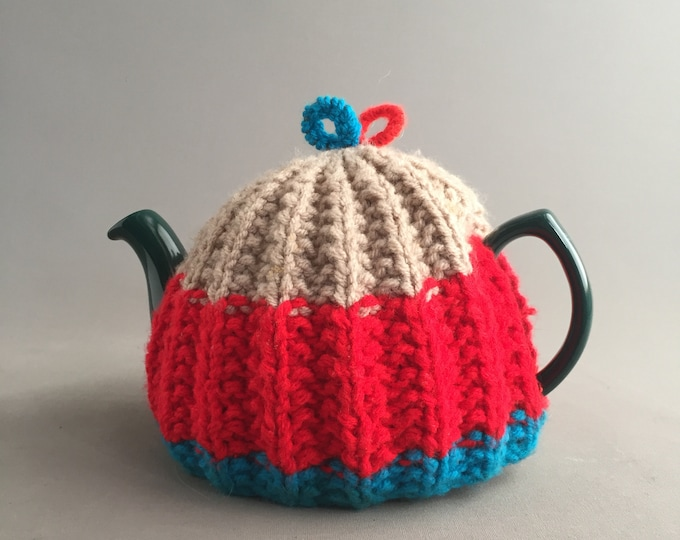 large tea pot with knitted cozy