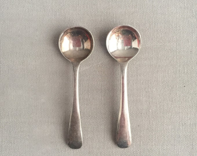 a pair of silver plated condiment spoons