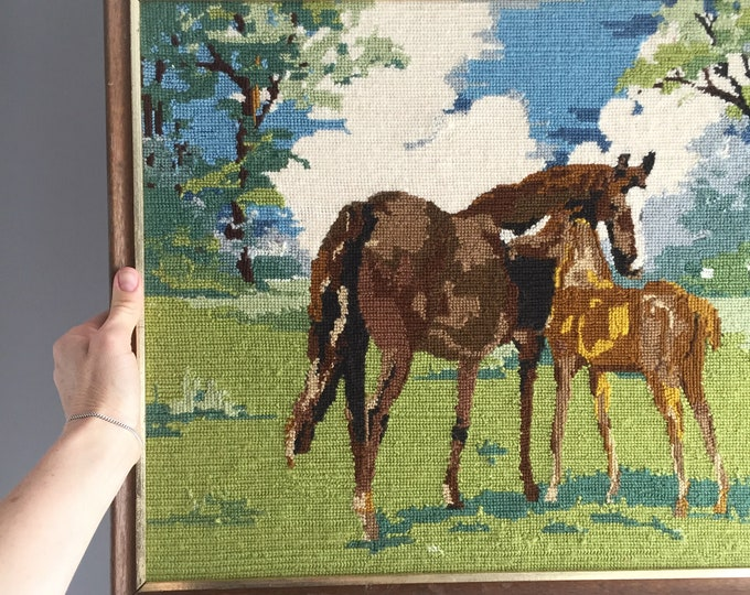 framed needlepoint picture of horse and foal