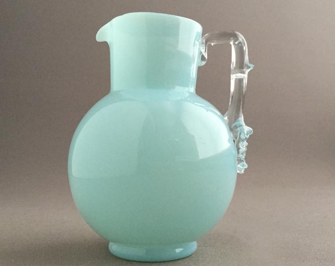 Little pale blue glass jug