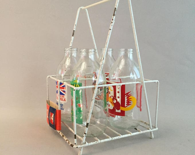 Vintage milk bottle set in carry frame 1970s
