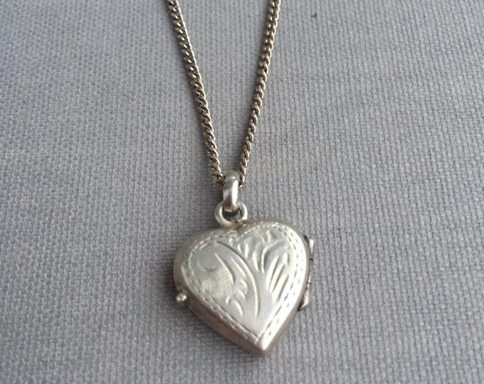 silver heart locket on silver chain