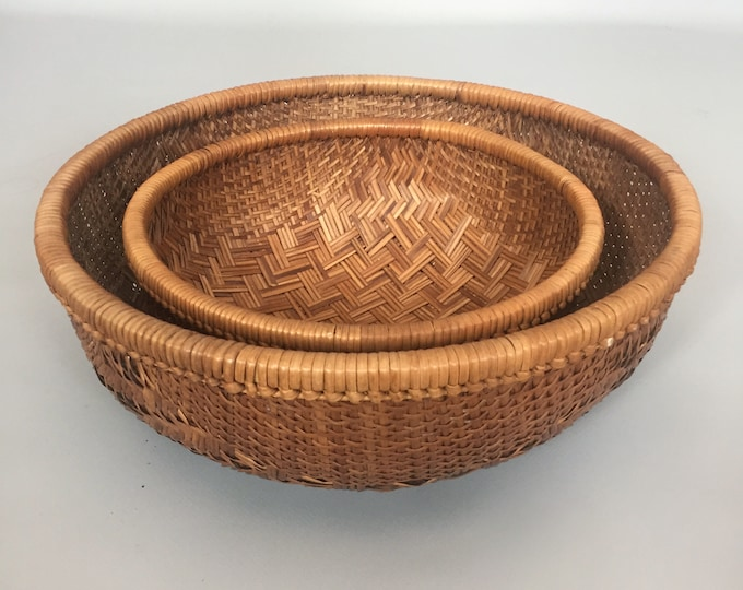 pair of hand woven baskets