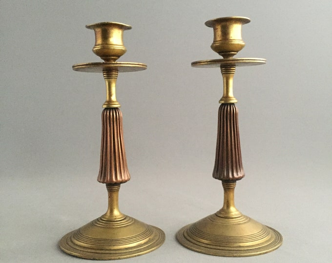 brass and copper candlestick holders
