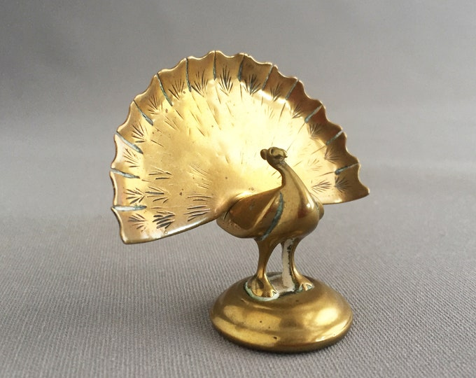 brass ornamental peacock