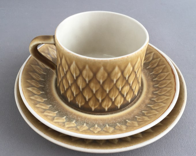 Jens H. Quistgaard Relief tea cup saucer and cake plate