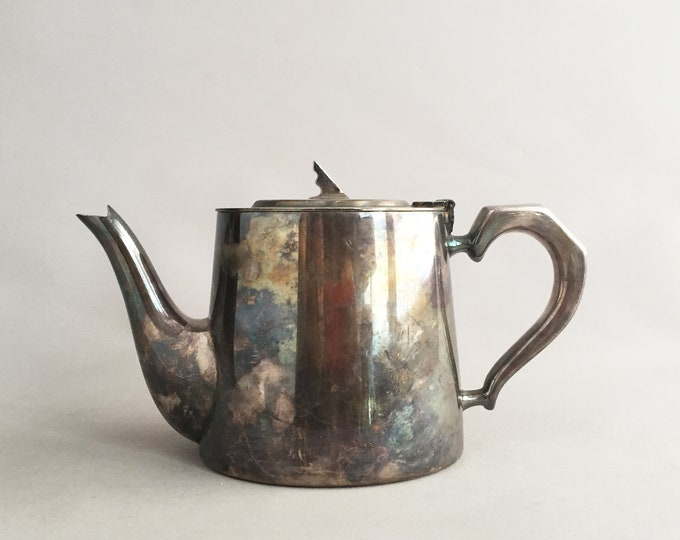 Old silver tea pot