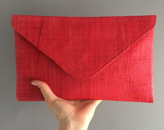red raffia envelope clutch bag